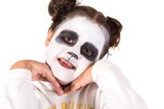 有面孔油漆的女孩 免版税库存照片