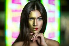 有面孔的金黄部分的妇女 库存图片