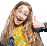 有面孔绘画的女孩 免版税库存照片