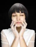 有面粉印刷品的妇女在面孔的 库存照片