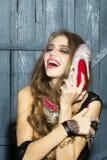 有鞋子的时髦的女人 图库摄影