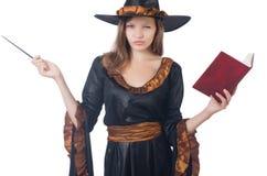 有鞭子和书的巫婆 免版税图库摄影