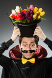 有鞭子的滑稽的魔术师人 库存照片