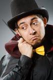 有鞭子的滑稽的魔术师人 免版税图库摄影