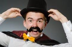 有鞭子的滑稽的魔术师 库存照片