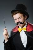 有鞭子的滑稽的魔术师 库存图片