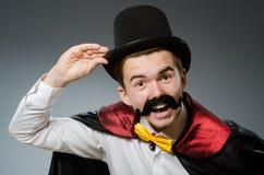 有鞭子的滑稽的魔术师 图库摄影
