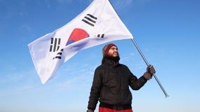 有韩国旗子的男性爱好者高兴并且支持运动员 影视素材