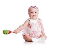 有音乐玩具的女婴 免版税库存照片