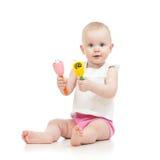 有音乐玩具的逗人喜爱的女婴 库存照片