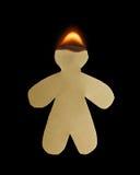 有顶头烧伤的纸人在火焰 库存照片