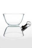 有颊须的玻璃碗从与反射垂直的边 库存照片