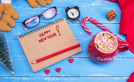 有题字的新年快乐纸笔记本 库存图片