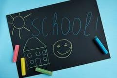 有题字`学校`的黑人委员会 免版税库存图片