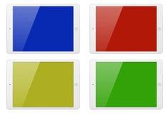 有颜色屏幕的四台片剂计算机 库存照片