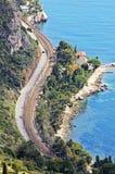 有风法国海滨的路 免版税库存照片