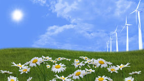 有风轮机的用花装饰的草甸 免版税库存照片