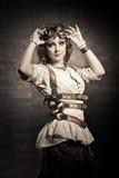 有风镜的Steampunk女孩 古板 库存照片