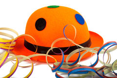有飘带的橙色狂欢节帽子 库存照片