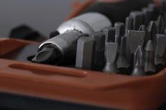 有飞利浦磁头的螺丝刀在与各种规模的被咬住的集合的案件 免版税库存图片