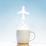 有飞机标志的咖啡杯 库存图片