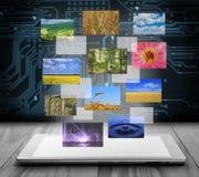 有飞行图片的片剂个人计算机 免版税图库摄影