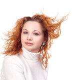 有飞行头发的女孩 免版税库存图片