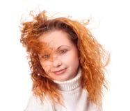 有飞行头发的女孩 免版税图库摄影