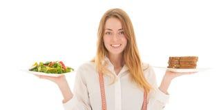 有饮食的妇女 免版税库存照片