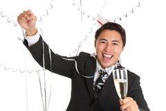 有香槟玻璃的愉快的当事人人 库存图片