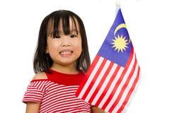 有马来西亚旗子的亚裔中国小女孩 库存图片