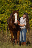 有马的美丽的女孩 图库摄影
