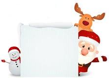 有驯鹿和雪人的圣诞老人与空白的标志 库存照片