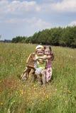 有骑马的男孩的女孩 免版税库存照片