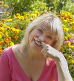 有髭的微笑的妇女 免版税库存照片