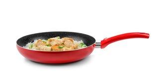 有鸡肉和大米的煎锅 免版税库存照片