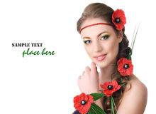 有鸦片的美丽的妇女在头发 免版税库存图片