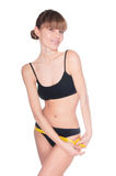 有黄色评定的美好的运动的妇女身体在空白backgro 库存照片