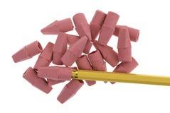 有黄色铅笔的红色橡皮擦在白色背景 免版税库存照片