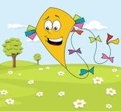 有黄色风筝的晴朗的草甸在蓝天 免版税图库摄影