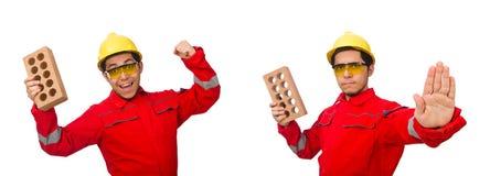 有黏土砖的建筑工人在白色 免版税图库摄影