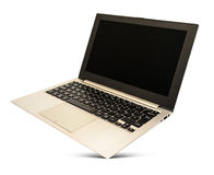 有黑屏幕的盘旋的玫瑰色金膝上型计算机 库存照片