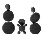 有黑色石头的子项的家庭 免版税库存图片