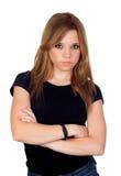 有黑色衬衣的可爱的恼怒的妇女 免版税图库摄影