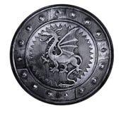 有龙标志的圆的盾 库存照片