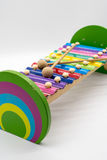 有12个五颜六色的声调的木琴玩具 免版税库存图片