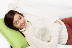 有年轻亚裔的妇女一懒惰天 图库摄影