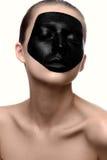 有黑体字的秀丽女孩在白色皮肤 库存图片