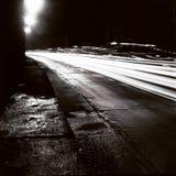 有移动交通光的隧道在黑白 图库摄影