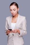 有移动电话的女实业家 图库摄影